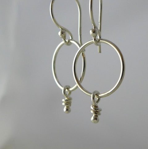 Loops, sterling silver hoop earrings with a knot.