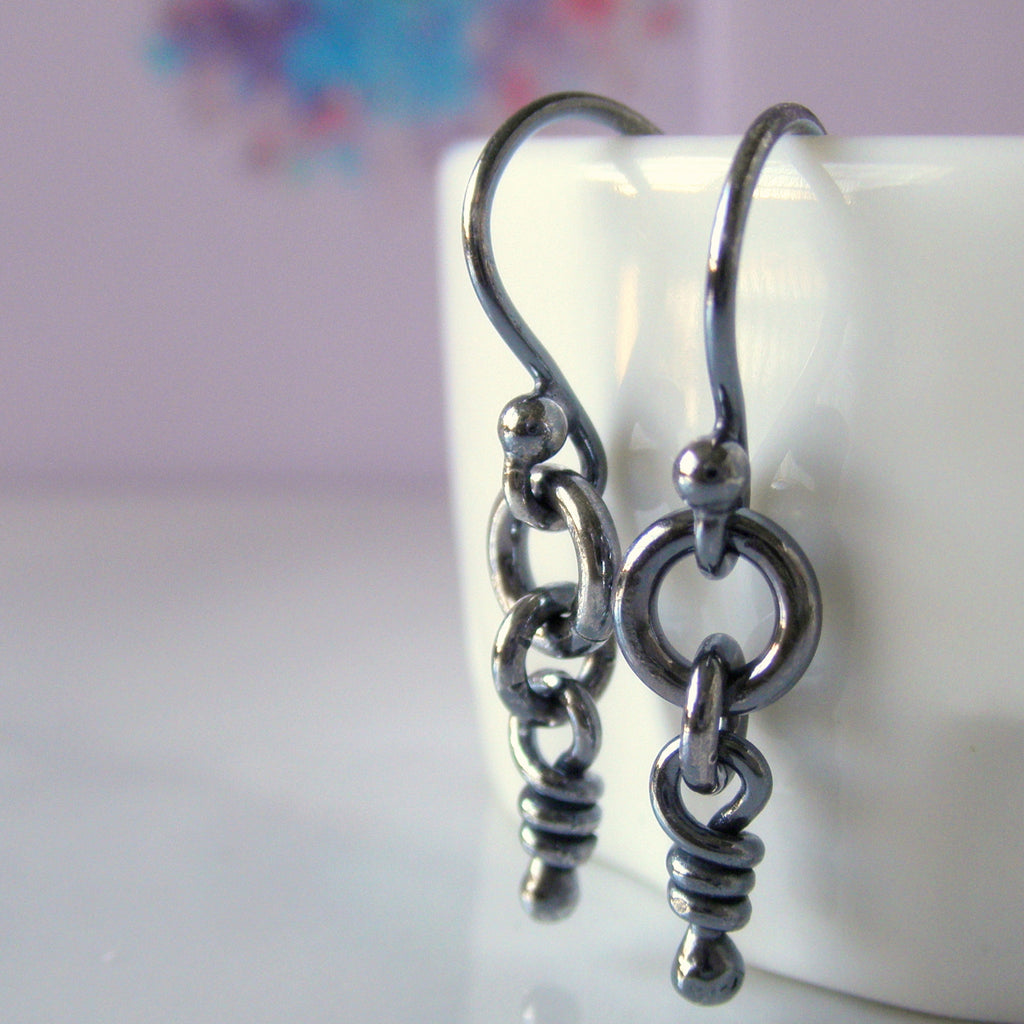 Ali knot earrings. Dark finish.