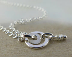 Rattle sterling silver pendant
