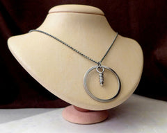 Wheel with knot, sterling silver pendant