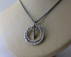 Lunar sterling silver round pendant. Textured circle unique necklace