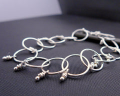 Loop sterling silver linked bracelet with knots