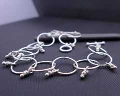 Sterling silver linked bracelet with knots