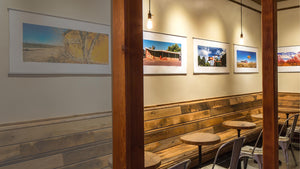 Peter Malinowski Vanishing Landscape photography exhibit installation at Handlebar Coffee Roasters in Santa Barbara, CA.  The Photos are installed with Silver Posterhangers by Jorgen Moller.