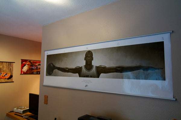 Michael Jordan Wings poster hanging on bedroom wall with 72 inch silver aluminum poster hanger