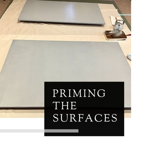 Priming the surfaces of the mural boards by Kimberly English