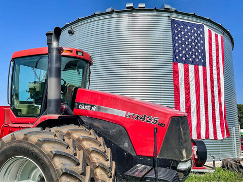 Large American flag on grain bin at Tice Family Farms