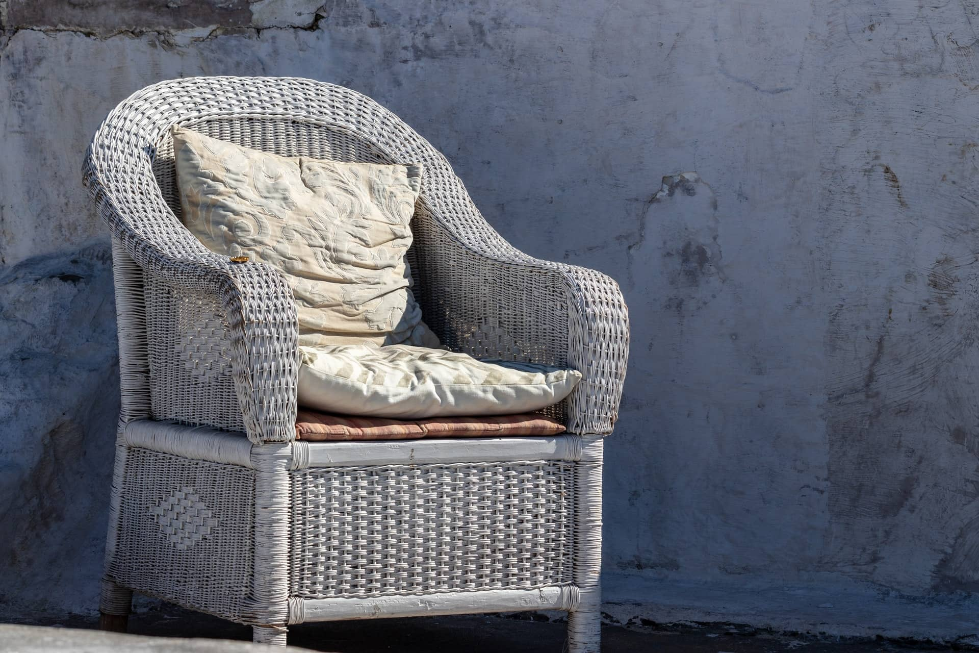 gray wicker furniture with pillow