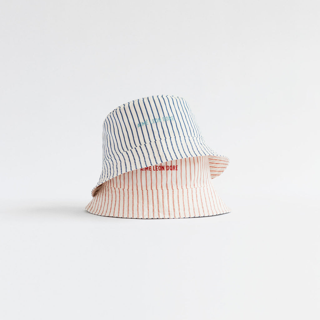 REVERSIBLE STRIPE BUCKET HAT