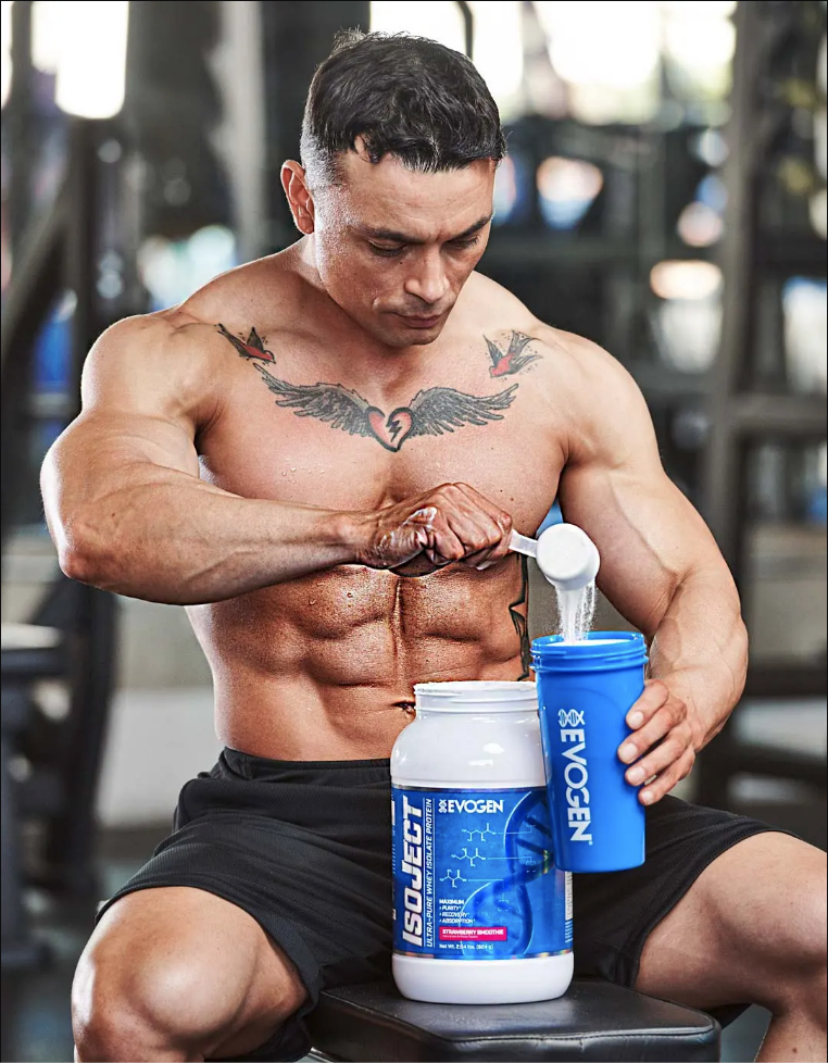 Athlete Frank Bugner scoops IsoJect out of a can into a shaker in the gym