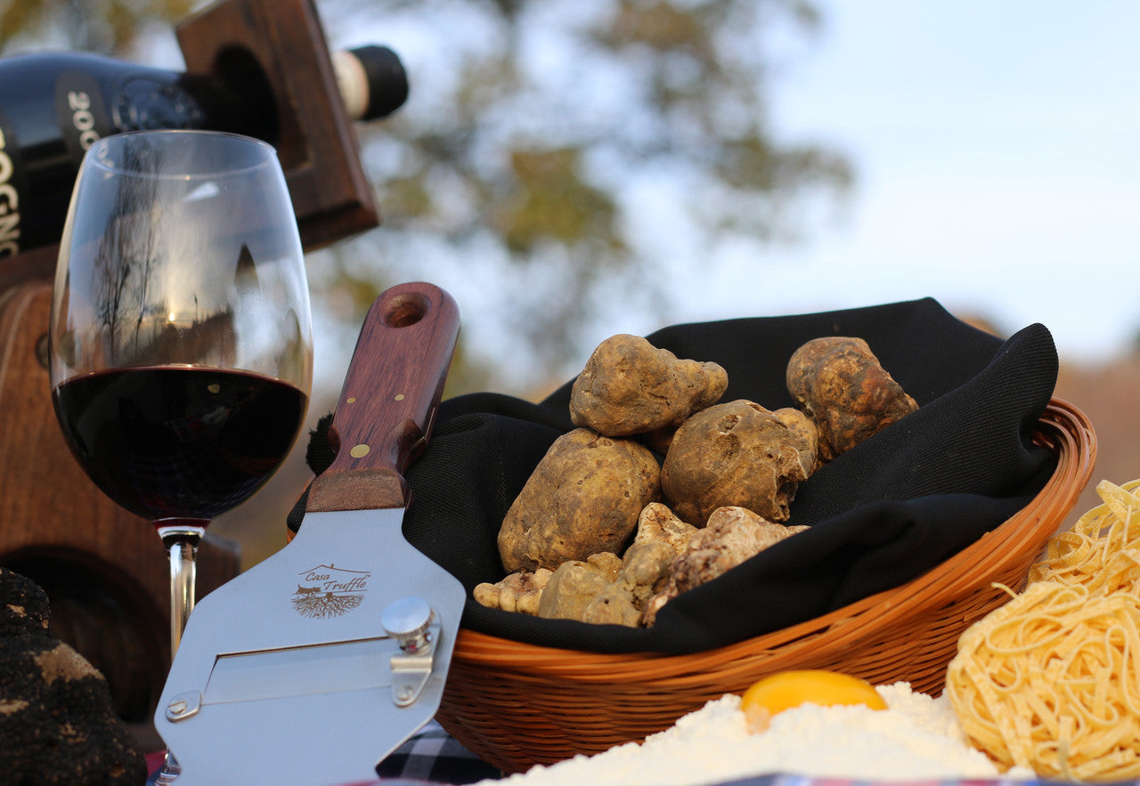 Glass of wine and a basket with white truffle