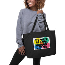 "Load image into Gallery viewer, ""HUMAN BEING. HUMAN DOING."" Exclusive art work from Harper Bizarre Art on your large tote bag."