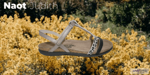leopard print sandal in white grey and black sitting on a bed of yellow flowers
