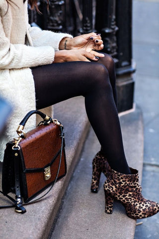 lady sitting in leopard print high heeled boots