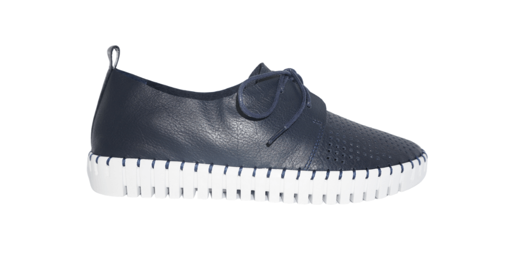 Navy sneaker with white sole