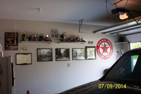 man cave garage outfitted with Pit Products diamond plate wall shelves