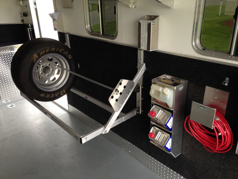 trailer storage solutions including a 4 foot tire rack, trailer wall mount cord hanger, trailer gallon jug rack