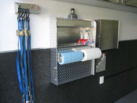various car hauling trailer storage and organization solutions such as a ratchet strap hanger and workstation