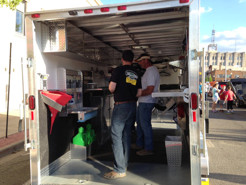showing people the trailer storage solutions we built at pit products in the show trailer