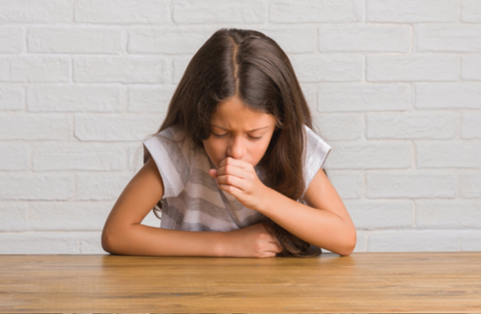 Young Girl Experiencing a Wheezy Cough as Asthma Symptom