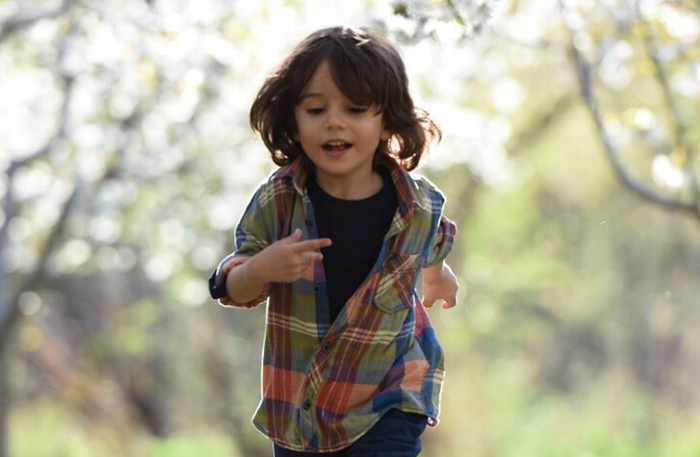 Young Boy Happily Running After Using Nebulizer Treatment