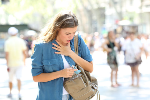 Women Holding Her Chest Experiencing Adult-Onset Asthma