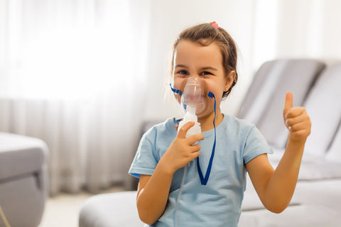 Young Girl Happily Using Nebulizer Treatment for Asthma