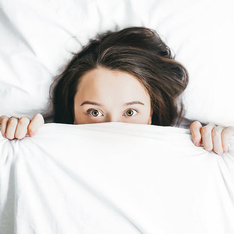 Women Hiding Face Under Bed Sheets Avoiding Flu Season