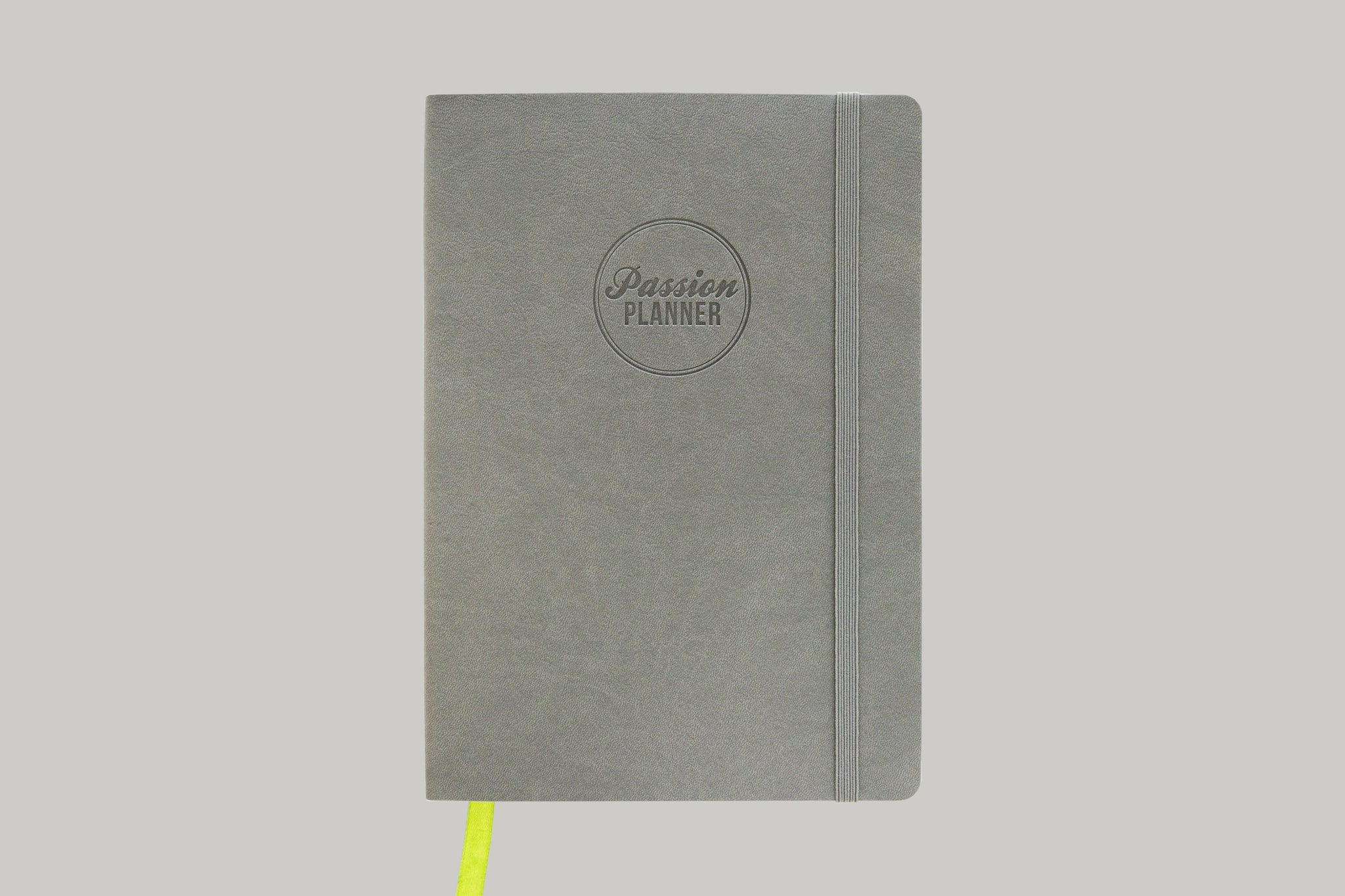 Gray Passion Planner with Lime Green Ribbon Against Light Gray Background