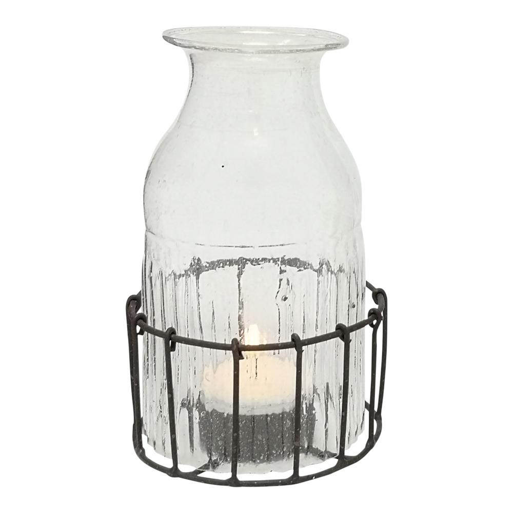 BOTTLE T-LIGHT IN BASKET CLEAR PKD 4 £6.23 EA.