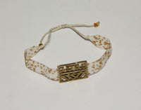Bracelet with gold look plate