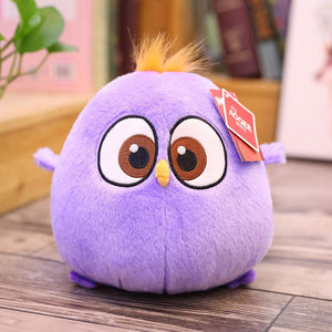 purple chicken stuffed animal with orange hair