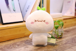 cute plushie with laughing face and small eyes