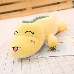 yellow dinosaur plushie with tongue out