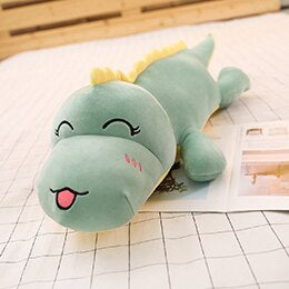 green dinosaur plushie with tongue out