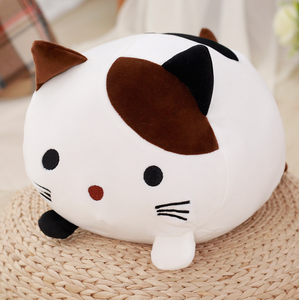 cute hello kitty like plushie in white and brown