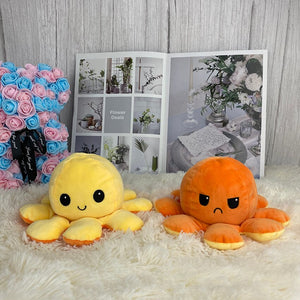 cute yellow and orange octopus plush toy reversible into smiley and angry face