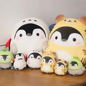 A family of little penguin plushies