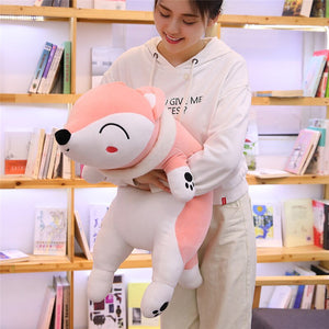 girl hugging pink fox plushie