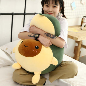 girl hugging avocado plushie