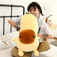 Load image into Gallery viewer, girl playing with avocado plushie