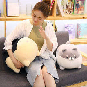 girl hitting the butt of black angry shiba inu plushie and grey plushie