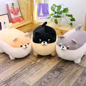 light brown, black, and grey angry shiba inu plushies side by side