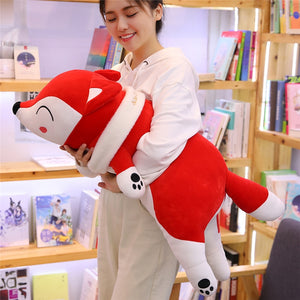 girl hugging red fox plushie