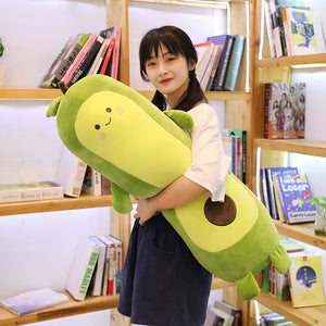 girl holding avocado long pillow plushie