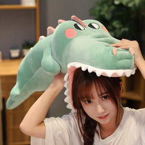green alligator/crocodile plushie on girl's head