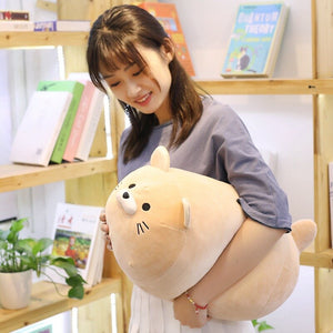 girl hugging khaki cat plushie pillow
