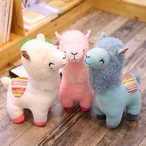 white, pink, and blue alpacas llamas plushies