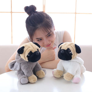 cute pug dog in elephant plushie and cute pug dog in rabbit plushie