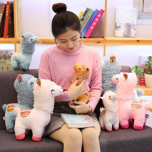 brown, pink, white and blue alpaca llama plushies
